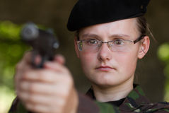 Female soldier targeting with a gun Stock Photos