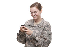 Female soldier text messaging Stock Images