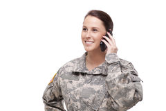 Female soldier using mobile phone Stock Image