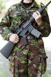 Female soldier witha gun on guard Stock Images