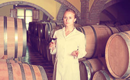 Female sommelier in wine cellar Royalty Free Stock Image