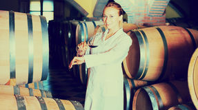 Female sommelier in wine cellar Royalty Free Stock Photography