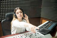 Female sound technician indicating to start radio show Stock Photo