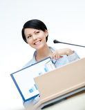 Female speaker at the podium Royalty Free Stock Images