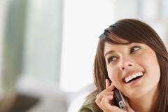 Female speaking on the cellphone Royalty Free Stock Photo