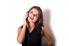 Female speaking on phone isolated on white Stock Photography