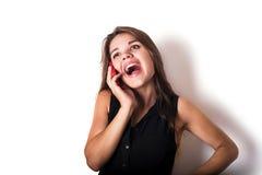 Female speaking on phone isolated on white Stock Image