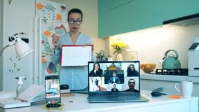 Female specialist is filming herself during an online meeting. Group of colleagues talking using video conference app