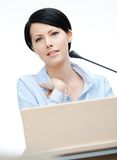 Female speech maker at the podium Royalty Free Stock Image