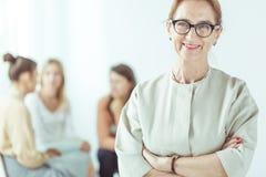 Female spiritual guide. Portrait of elderly female spiritual guide at work royalty free stock image
