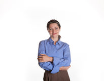Female Spokesperson with arms folded. Isolated shot of an adult woman with arms folded wearing a blue shirt with copy space Stock Image