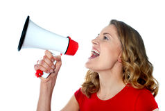 Female spokesperson holding megaphone. Isolated over white Royalty Free Stock Photography