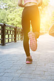 Female sport fitness runner jogging outdoors on bridge in spring. Female sport fitness athlete runner jogging outdoors on bridge in spring or summer. Healthy Stock Images