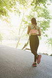 Female sport fitness runner jogging outdoors in spring or summer. Female sport fitness athlete runner jogging outdoors in spring or summer. Healthy young asian Stock Photo