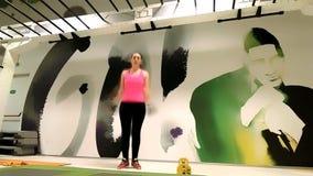 Female sportive doing jumping jacks stock video