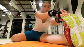 Female sportive doing stretching exercices stock video footage