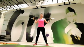 Female sportive executing exercises with weights stock video
