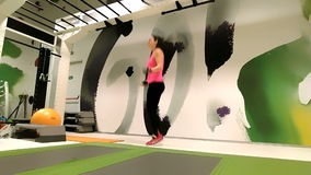 Female sportive executing jumping rope stock video