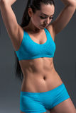 Female in sports clothing relaxing after workout Royalty Free Stock Photo