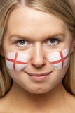 Female Sports Fan With St Georges Flag On Face Stock Photo