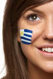 Female Sports Fan With Uruguayan Flag Painte Stock Photo