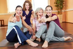 Female sports group holding thumbs Stock Photography
