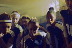 Female sports team in huddle Stock Images