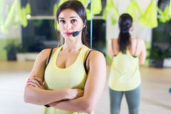 Female sports trainer with microphone Fit woman. Standing at fitness club stock images
