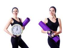 The female sportsman holding rug and clock isolated on white Stock Images