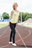 Female in sportswear doing exercises Stock Photography