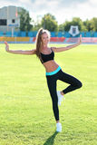 Female in sportswear doing exercises Stock Images