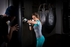 Female sporty boxer in boxing gloves training with her couch and stock photography