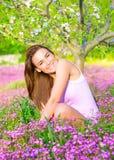 Female on springtime backyard Stock Images