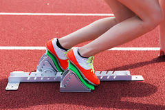 Female sprinter in the blocks Stock Images