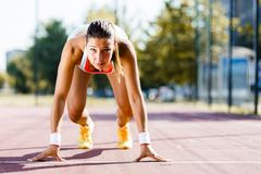 Female sprinter getting ready for the run Royalty Free Stock Images
