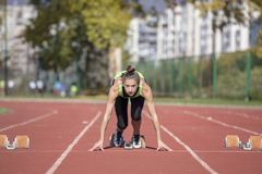 Female Sprinter Getting Ready to Start The Race.  Royalty Free Stock Images