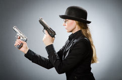 The female spy with weapon against gray Stock Photo