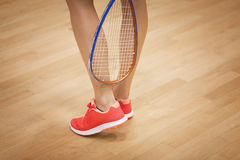Female squash player playing squash. A young squash player,squash court Royalty Free Stock Image