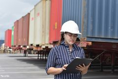 Female staff checking the container. Stock Photo
