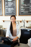 Female Staff In Coffee Shop Royalty Free Stock Photos