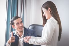 Female staff getting compliment from Boss. Female staff is getting compliment from Boss royalty free stock image