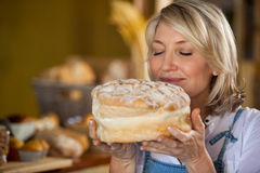 Female staff smelling a sweet food Royalty Free Stock Image
