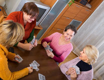Female staking money during bridge Royalty Free Stock Photography