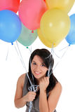 Female standing with air balloon Stock Image