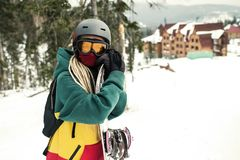 Female standing outdoors holding a snowboard stock photography