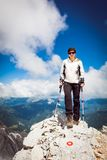 Female standing on top a mountain Royalty Free Stock Image