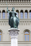 Female Statue of Berna in Bern, Switzerland. BERN, SWITZERLAND - DECEMBER 23, 2015: Female Statue of Berna placed on the top of Berna Fountain (Bernabrunnen) stock photography