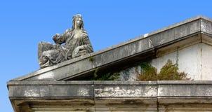 Female Statue over a Pediment Stock Photo