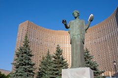 Female statue with white dove against Cosmos Hotel in Moscow Stock Image