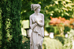 Female statue. Statue of a woman in the park Royalty Free Stock Photo